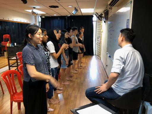 Dominic teaching group singing